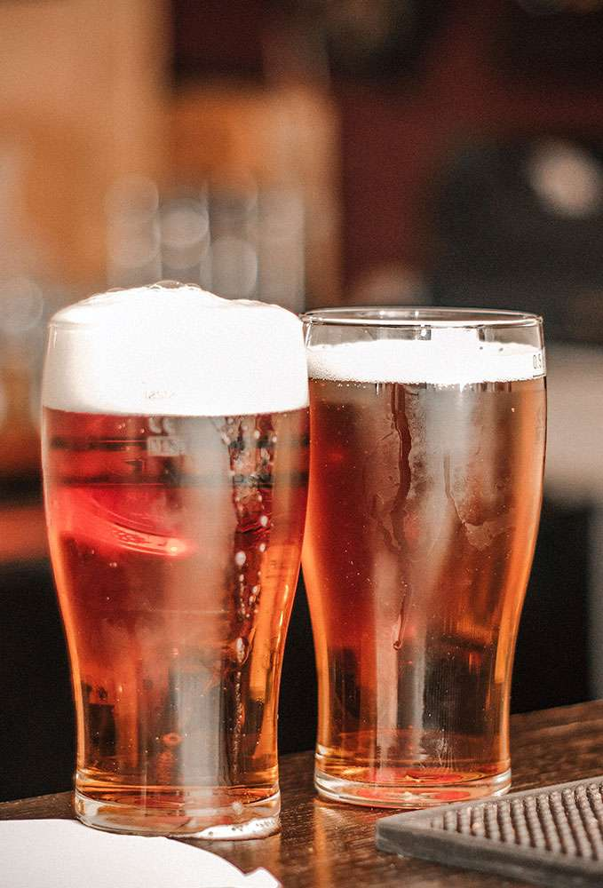 Two pint glasses with beer