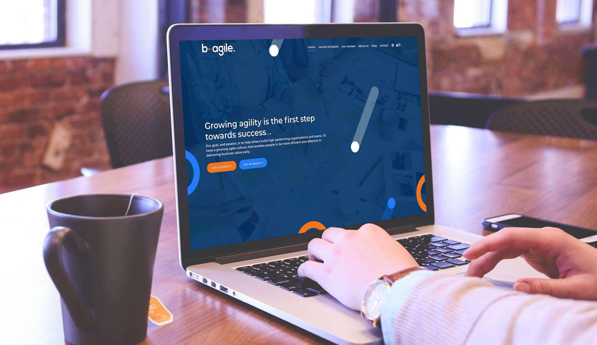 Bagile mocked up on macbook pro in cafe